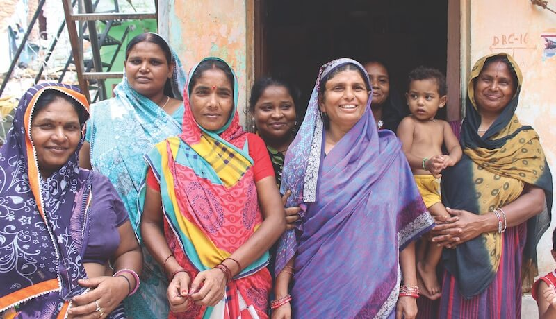 Ranjan (third from the left) and fellow loan group members with microfinance partner Shikhar